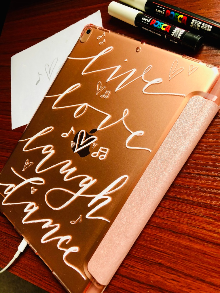 white Posca marker in modern calligraphy in iPad cover