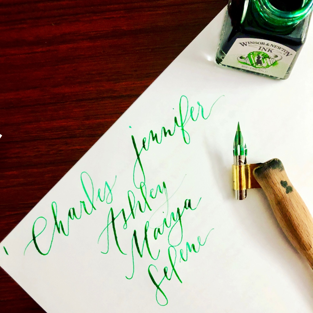 calligraphy in green ink of our family tree